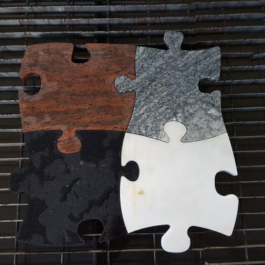 puzzle spessore 30 mm realizzato con vari marmi e graniti