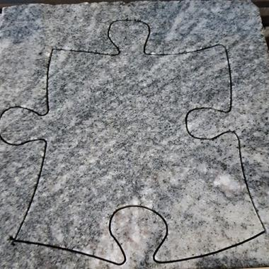 taglio con IKC pezzo puzzle da granito tonalite spessore 30 mm